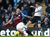 Alan Hutton and Craig Bellamy