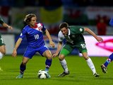 Luka Modric of Croatia and Andy King of Wales