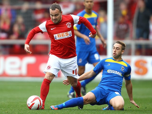 Fleetwood Town's Lee Fowler and AFC Wimbledon's Sammy Moore