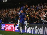 Ramires celebrates scoring with Juan Mata on his back