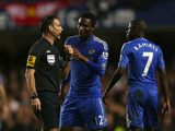 Mark Clattenburg argues with John Obi Mikel