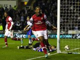 Theo Walcott celebrates scoring Arsenal's sixth