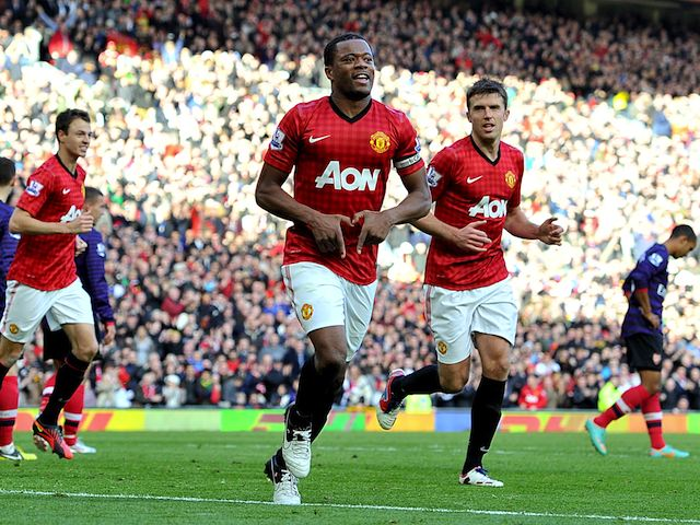 Patrice Evra celebrates scoring United's second