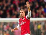 Lukas Podolski celebrates scoring Arsenal's second