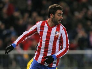 Adrian Lopez celebrates scoring for Atletico Madrid
