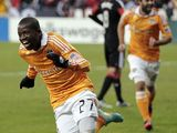 Boniek Garcia celebrates scoring for Houston Dynamo in the MLS playoff on November 18, 2012