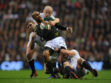 South Africa's JP Pietersen is held back by England's Tom Youngs and Joe Launchbury on November 24, 2012