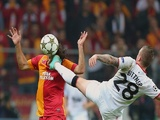 Man Utd's Alex Buttner challenges Hamit Altintop on November 20, 2012