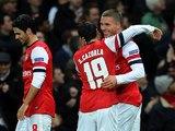 Lukas Podolski celebrates scoring a pretty-special-too goal for Arsenal on November 21, 2012