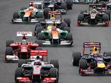 Mark Webber, Jenson Button and Fernando Alonso steer their cars at the beginning of the Brazilian GP at Interlagos on November 25, 2012