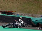 Pastor Maldonado walks away after crashing his car into the wall on November 25, 2012