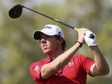 Rory McIlroy tees off during the final round of the World Tour Championship in Dubai on November 25, 2012