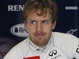 Sebastian Vettel in his team's pit on November 23, 2012