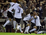 Valencia's Sofiane Feghouli is mobbed by team-mates after his goal against Bayern on November 20, 2012