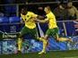 Norwich defender Sebastian Bassong celebrates his last gasp equaliser on November 24, 2012