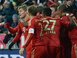 Toni Kroos is congratulated by team mates moments after scoring on December 1, 2012