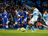 Carlos Tevez steps up to score the penalty to equalise for his team against Everton on December 1, 2012