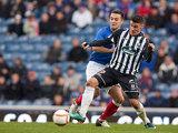 Rangers' Chris Hegarty and Elgin's Stuart Leslie battle for the ball on December 2, 2012