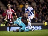 Jamie Mackie has a shot blocked for QPR on November 27, 2012