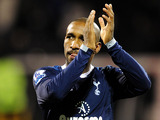 Jermain Defoe applauds fans at the final whistle on December 1, 2012