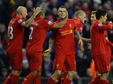 Danniel Agger is congratulated by team mates after scoring the opener on December 1, 2012
