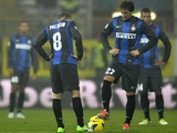 Inter forward's Diego Milito and Rodrigo Palacio kick-off following a Parma goal on November 26, 2012