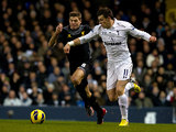 Steven Gerrard and Gareth Bale battle for the ball on November 28, 2012