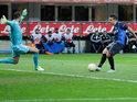 Inter Milan's Marko Livaja slots the ball past Neftci goalkeeper Sasa Stamenkovic on December 6, 2012