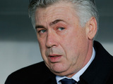 Paris Saint Germain coach Carlo Ancelotti watches his team on December 8, 2012