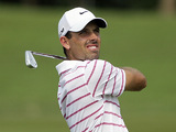 Charl Schwartzel takes a shot from the fairway in the final round of the Thailand Golf Championships on December 9, 2012