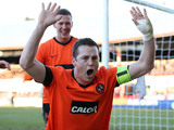 Dundee United's Jon Daly celebrates scoring a penalty against rivals Dundee on December 9, 2012