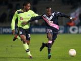 Bordeaux's Maxime holds up Newcastle's Nile Ranger on December 6, 2012