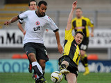 Accrington Stanley's Rommy Boco and Burton Albion's Lee Bell battle for the ball on December 9, 2012