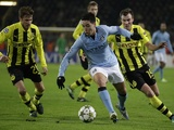 Man City's Samir Nasri takes on the Borussia Dortmund defence on December 4, 2012
