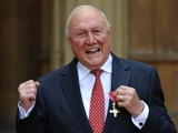 Broadcaster Stuart Hall receiving his OBE on March 22, 2012