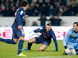 Paris Saint Germain's Ezequiel Lavezzi is congratulated by Zlatan Ibrahimovic after scoring his team's second goal on December 8, 2012