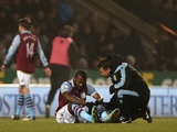 Aston Villa striker Darren Bent is treated for injury at Carrow Road on December 11, 2012