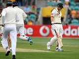 Australia's Ed Cowan walks after being dismissed for four against Sri Lanka on December 14, 2012