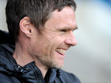 Fleetwood Town manager Graham Alexander smiles during the match against Gillingham on December 15, 2012