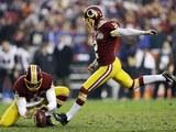 Kai Forbath kicks the winning goal for the Washington Redskins on December 9, 2012