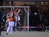 Arsenal captain Thomas Vermaelen scores a late equaliser against Bradford on December 11, 2012