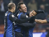 Inter forward Antonio Cassano celebrates with teammates after his goal against Verona on December 18, 2012