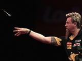 Simon Whitlock throwing during his second round match in the World Darts Championship on December 22, 2012