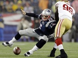 Patriots QB Tom Brady is sacked during defeat to the 49ers on December 16, 2012