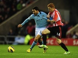 City striker Carlos Tevez is challenged by Sunderland's Jack Colback during their game on December 26, 2012