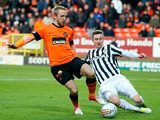 Dundee United's Johnny Russell and St Mirren's Paul Dummet battle for the ball on December 30, 2012
