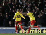 Matej Vydra is congratulated by team mate Troy Deeney after scoring his team's second goal on December 29, 2012