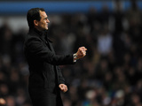 Wigan manager Roberto Martinez celebrates his team's goal on December 29, 2012