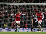 Theo Walcott celebrates after scoring his second against Newcastle on December 29, 2012