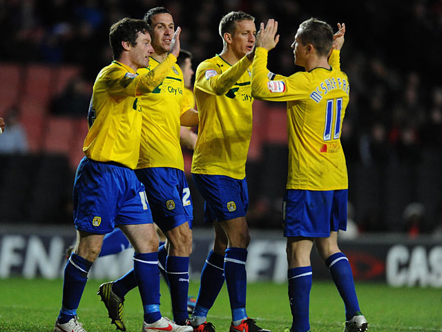 Stephen Elliott is congratulated by team mates after scoring his second goal on December 29, 2012